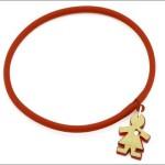 bracciale in caucciù con ciondolo birikina in policarbonato con strass e lastra galvanica € 6,50 birikini b.expressive